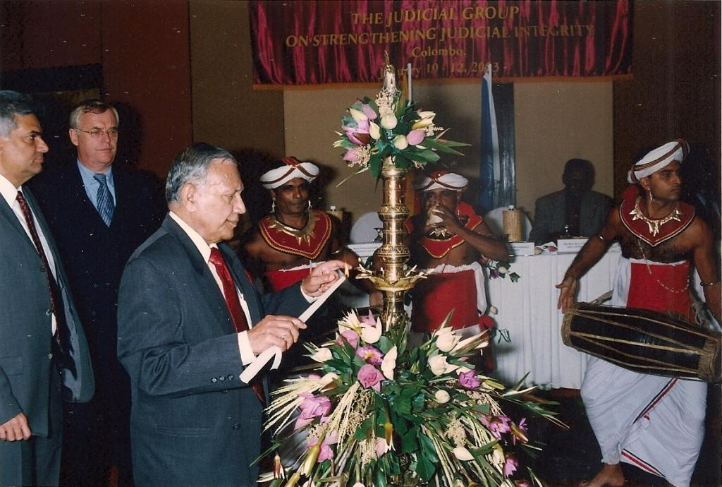 Judge Weeramantry lights the ceremonial lamp